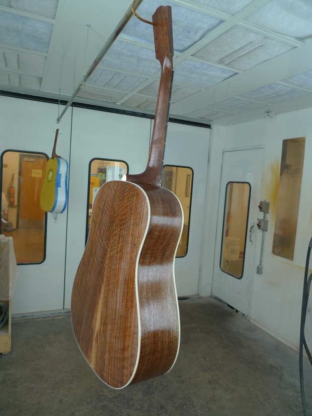Getting coats of nitrocellulose lacquer in our awesome spray booth