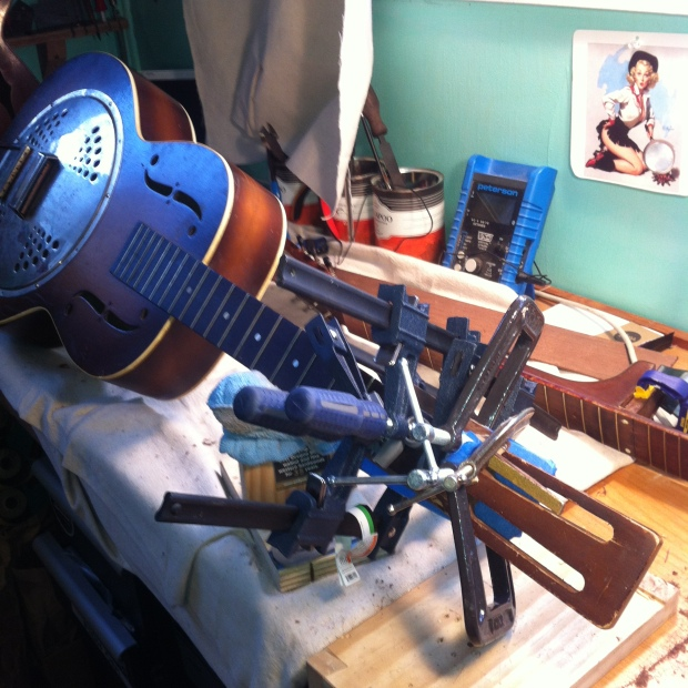 The old Kay gets its first layer of repair veneer to permanently fix the headstock.