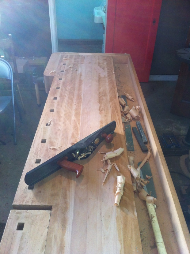 The bench must be flattened and trued side-to-side, and end-to-end.  Hello Jointer plane!