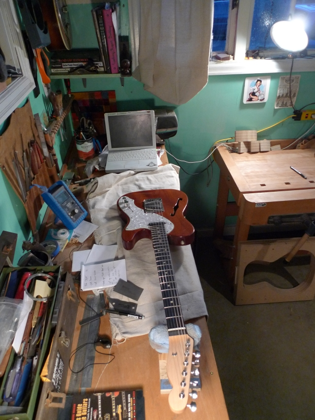 On the set up bench is a customer's Thinline Telecaster getting a fret dress and set up.  I'm currently using a painters drop cloth as instrument rest, after the violin workshop I visited in Philadelphia.  The bench's toolspace is getting steadily more organized as time goes by.