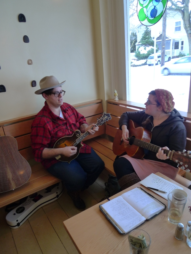 Here is the Coupe Duet playing at a local breakfast joint.  I am playing the Miller F5, and Joanna is playing an awesome x-braced Harmony conversion.
