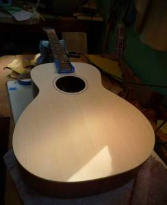 The guitar is carefully finish sanded to 320 grit (no scratches!)