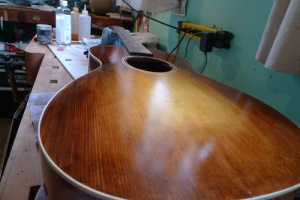"Coats of Shellac are ""polished"" on using a cotton pad.  Slow work but very enjoyable."