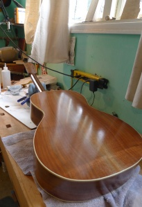 "The next step is ""spiriting off"" of the Shellac, where the surface is polished smooth and awesome."